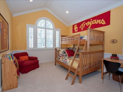 Upstairs bedroom with twin over full bunk beds, walk-in closet and en-suite bath