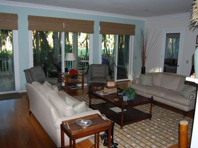 2nd view of living room that opens to porch & golf/lagoon views. Den is attached