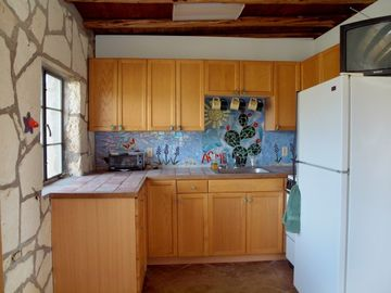 Cabin's Kitchen with Stove & Refrigerator. Glass Mosaic Accents.