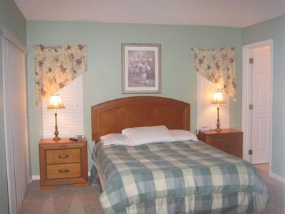 Haines City house rental - Master Bedroom with private bath and access to pool.