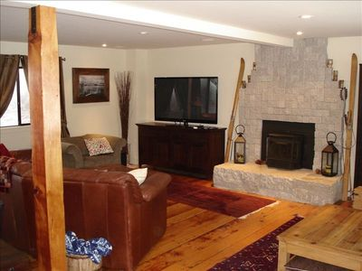 "60"" flat screen and pellet stove to enjoy resting on spacious leather couch."