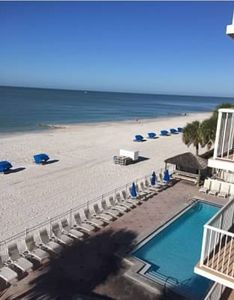 The balcony overlooks the pool, hot tub, beach, and Gulf of Mexico- Come Join us!