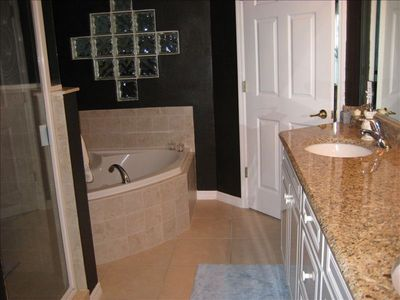Master bathroom with walk in shower and jacuzzi bath, double vanity