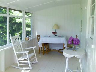 Rye cottage photo - Screened in porch overlooking spacious back yard and conservation land