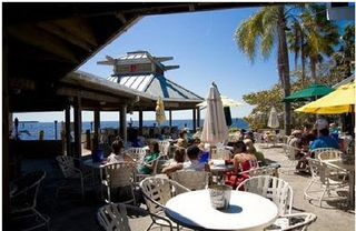 Tampa townhome photo - Community beach front TIKI BAR , evening live entertainment
