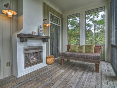 The 2nd floor porch features bench seating and outdoor fireplace.