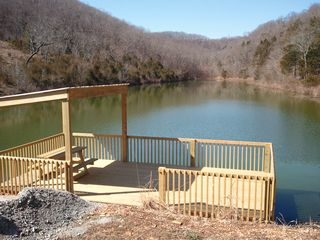 Branson cabin photo - Acres of woods for hiking. The private fishing lake has dock. Pets welcome!