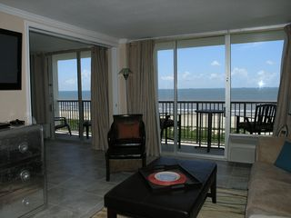 Galveston condo photo - Dining room view of both balconies overlooking the beach. Walls of glass.
