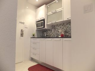 Isla Verde apartment photo - Custom made kitchen with quartz counter top. Fully equipped w cooking utensils.