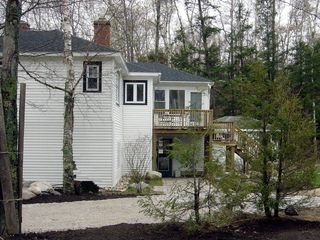 Manistee house photo - Beach-facing side of our house with separate cabin behind the trees.