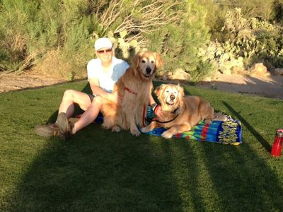 3 of our cute guests enjoying the sunset on tee-off green, in back of the condo