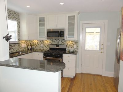Your gourmet kitchen has granite counters, glass tile, SS appliance. Complete!!!