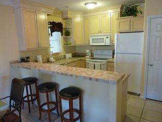 South Padre Island condo photo - Kitchen with beautiful tile countertop and bar top with seating for 3