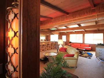 Joshua Tree house rental - Glamour in the high desert - spacious living room with tiki features and bar.