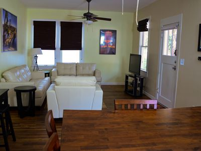 Large living room, from dining area perspective. Small desk - left.