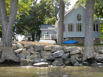 Viewing the cottage from the waterfront captures nature's beauty.