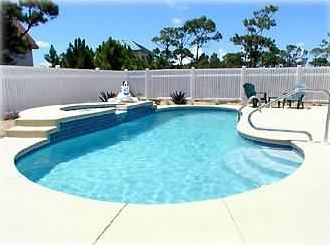 Large heated pool w/waterfall spa.  Generous decking, chairs with privacy fence.