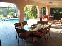 CANAL HOME, 3 BR/2 BA/2GA & HEATED POOL, GREAT LOCALE WITH REDUCED SUMMER RATES!