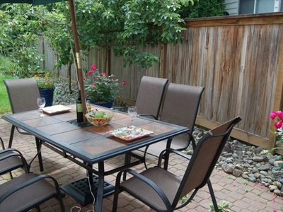 Outdoor dining on our patio with garden view.