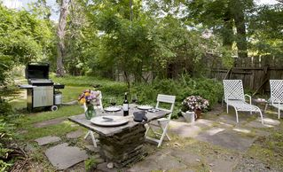 Woodstock studio photo - Herb Cottage: patio with a gas grill for outdoor cooking, dining + lounging