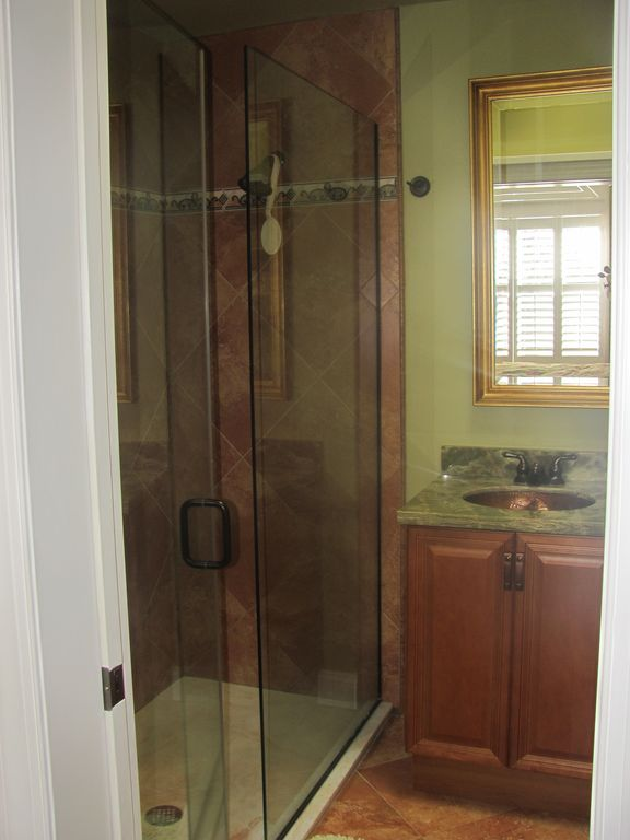 Master Bathroom has 2 sinks with Onyx countertop, and large shower