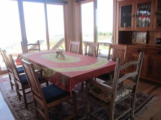 Jenner house photo - Cherry dining room set, expands to seat 10. Doors over wide to the deck.