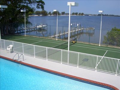 Pool, Tennis Court and Water view.