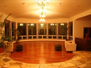 Living room 30' x 50' with 23' ceiling. 10' windows are 45' from ocean