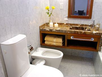Renovated bathroom with marble. Toilet and bidet.