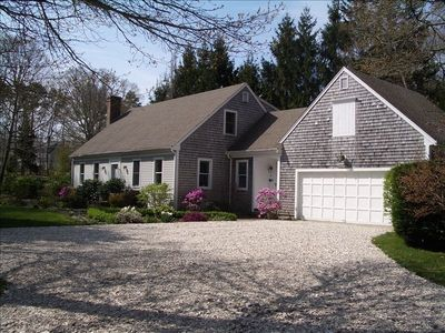 Front of House with Lovely Gardens, Woodland Privacy, 2-Car Garage, Private St.