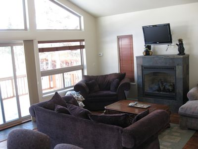 Family room upstairs with huge deck & fireplace
