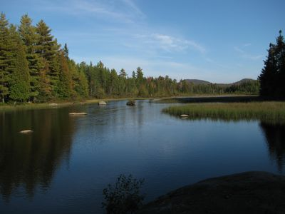 Paul Smiths chalet rental - Meacham Lake outlet: great paddling & fishing just 2 minutes from Camp Hatteras.