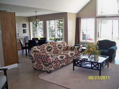 Black Lake cottage rental - Another view of the living room with dining area beyond.