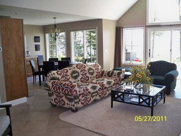 Another view of the living room with dining area beyond.