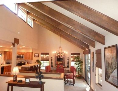Great Room with vaulted ceilings, designer touches, warm, inviting, & spacious!
