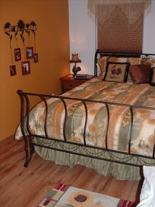 Master bedroom is located on the upper level with a king size bed.