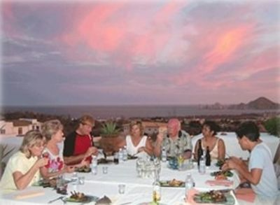Ames' Family Dinner for 10 on roof deck at Sunset - view of Lands' End