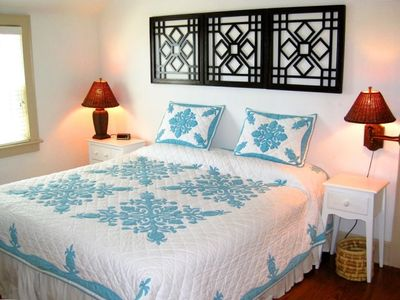 King Bedroom with Hawaiian design motif & HDTV adjoins the upstairs sun room
