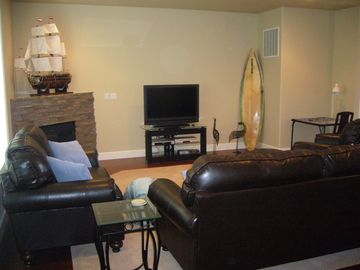 "Living Room with 42"" HD Flat Panel TV on main level."