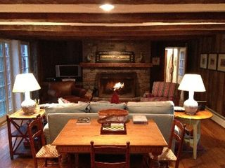 Woodstock farmhouse photo - Family room w/ field stone fireplace and french doors to deck. Satellite tv/dvd