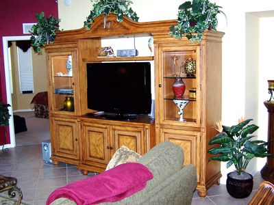 Beautiful entertainment center- with tap-tap mood dimmer light settings.