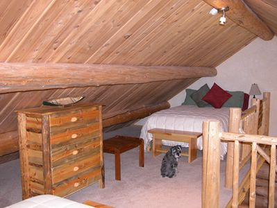 The loft has a queen bed and a full-sized bed. This is the full-sized bed.