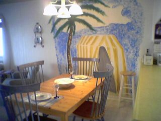 Vacation Homes in Ocean City condo photo - Eat dinner under the palm trees