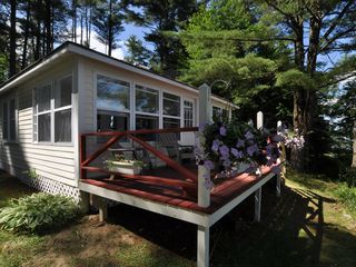 Unity cottage photo - Sunny deck overlooking pond