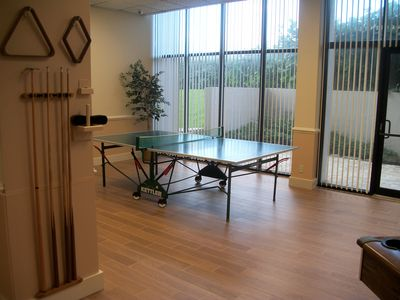 Social room for entertainment with pool table, ping-pong, piano, bar, library
