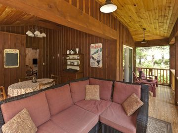 Screened in Porch with Sectional and Adirondack Chairs