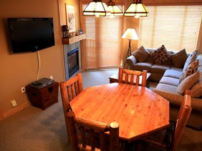 Dining area with seating for 6 and flat screen TVs in all rooms!