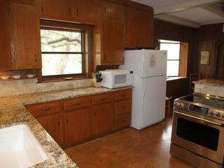 Fully stocked kitchen with granite counters, range, dishwasher, etc. - Wimberley house vacation rental photo