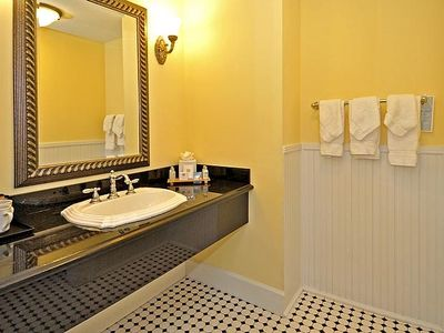 Luxurious vanity area, separate from the shower and commode for your convenience