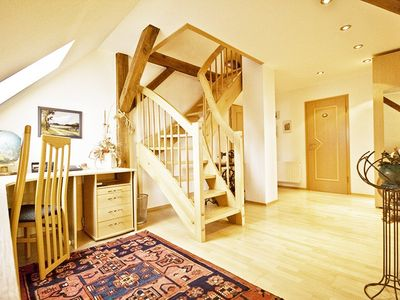 hall way with office nook and stairs to loft rooms